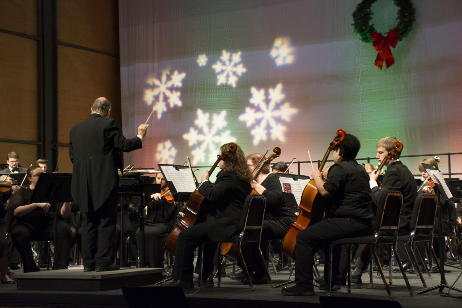 The symphony orchestra performs during the Holiday Gala.