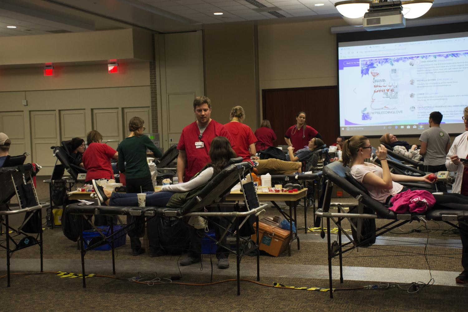 Jacob Thomas photo  University of Wisconsin-Platteville students pictured in Velzy Commons giving blood last week.