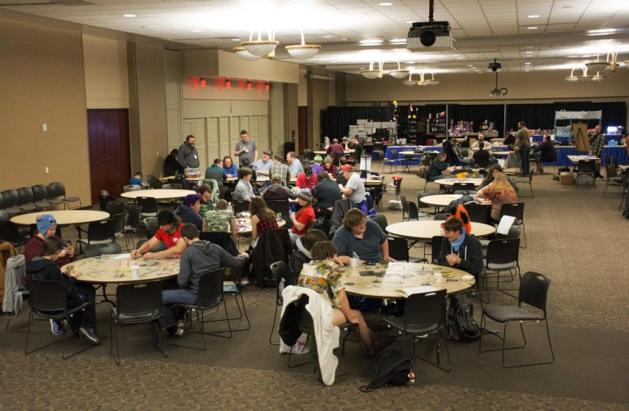 Jacob Thomas photo Plattecon attendees play tabletop games in Velzy Commons during the 32nd annual gaming convention.