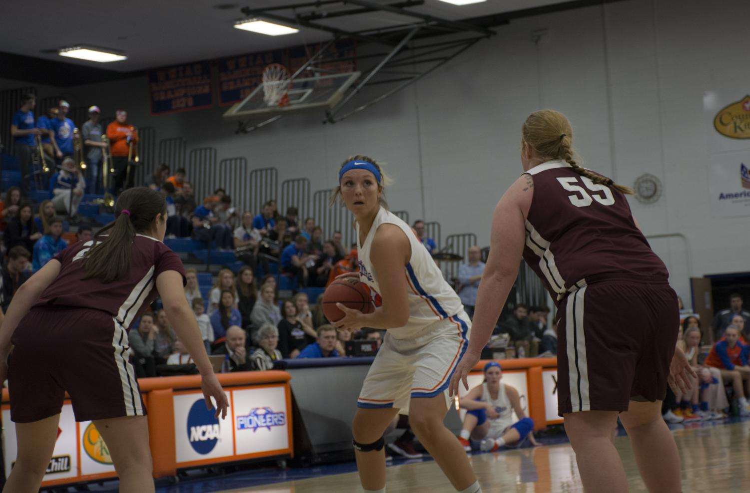 University of Wisconsin-Platteville's number 42 Lexis Macomber sizing up her options in a double team.