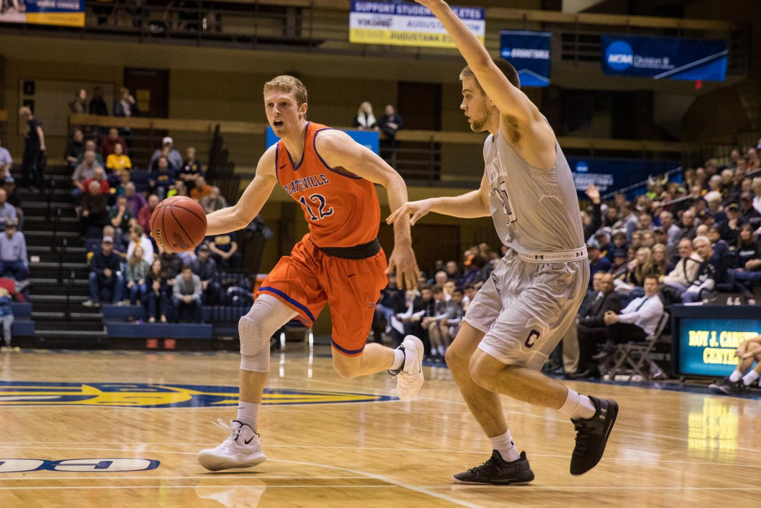 UW-Platteville Communications photo Pioneers' #12 Robert Duax driving into the paint during Friday night's game.