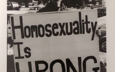 A protester marches outside of the UW-Platte- ville Student Cen- ter on the morn- ing of the visit from Rep. Steve Gunderson. This file photo from The Exponent on December 5, 1996 shows one of the anti-gay signs that greeted the recently outed Congressman.