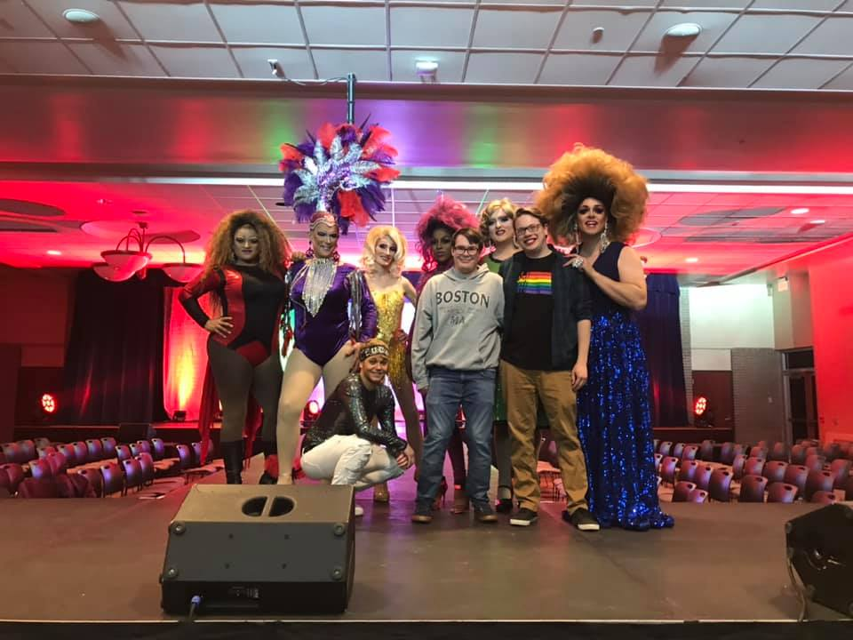 Pictured here above performers and organizers from the tenth annual Rainbow Rave.  Left to Right back row: Honey Love, Janelle Heart, Rylynn Vatile-Belle, Milange Cavalli, Roxi Heart (MC) and Kyra Vitale (MC) Left to right front row: Lucas Lee James, Bryant Copper and Jason Roth